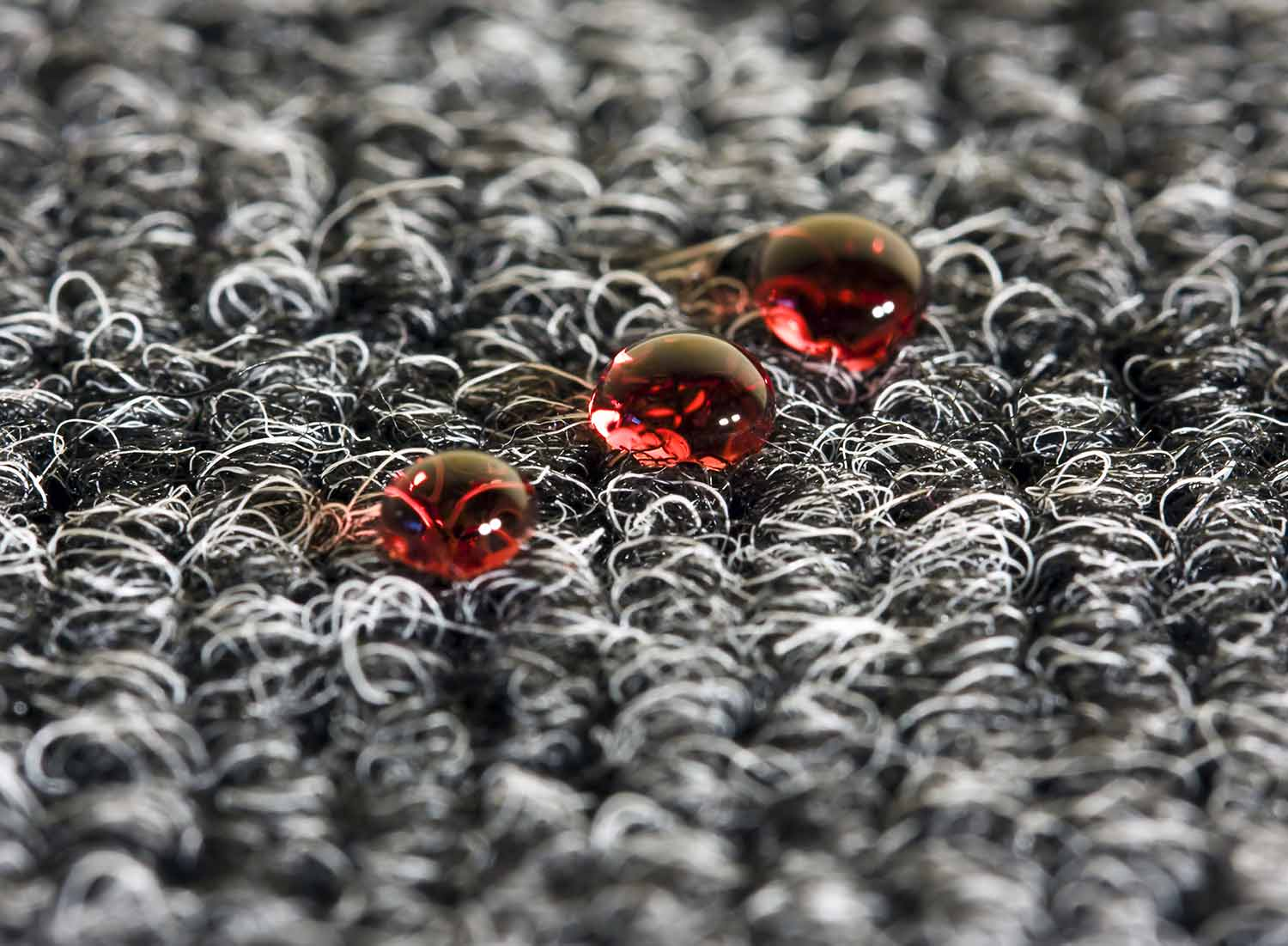 Droplets of wine on a carpet are no match for the professional and skilled workers at All Convention Cleaners.