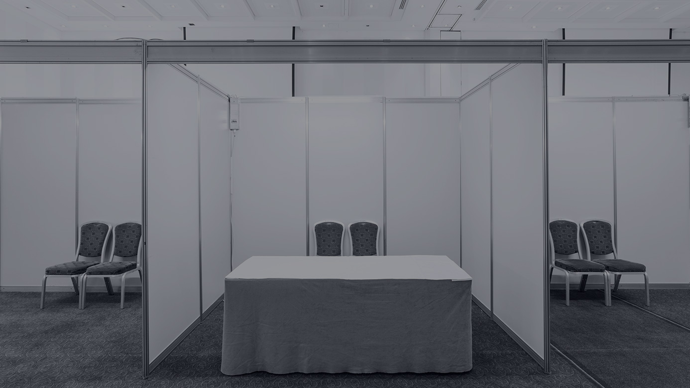 An empty trade show booth is cleaned and ready for the event.